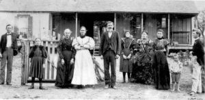 This photograph was taken about 1895, in front of the Johnson homestead. The successor house still stands just across the road from the Johnson family cemetery. The young girl in the picture, looking a bit angry and defiant, is my grandmother, Jessie Johnson (later Jessie Hatcher). She was the youngest of all the children, born in 1887. I find it very interesting that my grandmother lived and is buried in the very same place, about 85 years apart -- she died in 1973. I knew her quite well, she was my only living grandparent and a real influence as I was growing up. Through her especially I met a lot of the older Christadelphians of her generation and heard lots of stories.