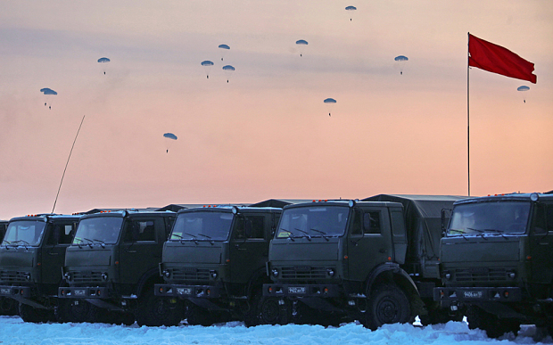 KOSTROMA REGION, RUSSIA. JANUARY 23, 2016. Servicemen of the 98th Guards Airborne Division of the Russian Airborne Troops descending with parachutes during military exercises. PHOTOGRAPH BY TASS / Barcroft Media UK Office, London. T +44 845 370 2233 W www.barcroftmedia.com USA Office, New York City. T +1 212 796 2458 W www.barcroftusa.com Indian Office, Delhi. T +91 11 4053 2429 W www.barcroftindia.com